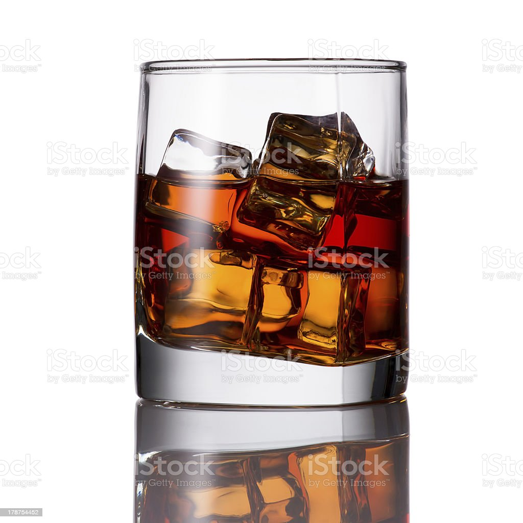 Whiskey with ice in a glass royalty-free stock photo