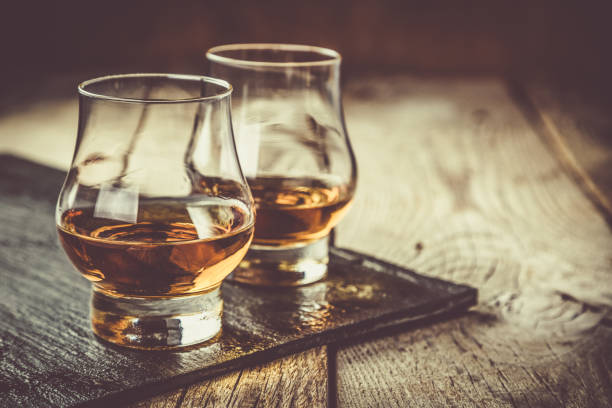 whiskey with ice in glasses - whiskey stock photos and pictures