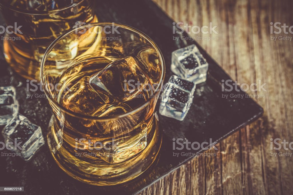 Whiskey with ice in glasses stock photo