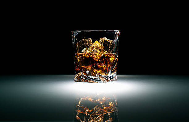 Whiskey with ice Whiskey glass with ice against dark background brandy stock pictures, royalty-free photos & images