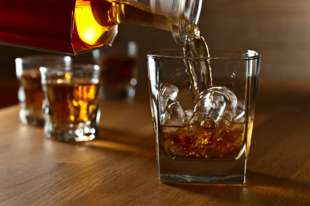 whiskey with ice . - whiskey stock photos and pictures