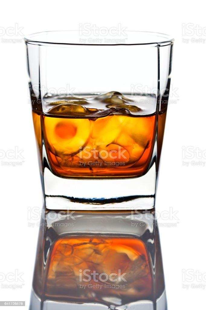 whiskey withl ice isolated on white background stock photo