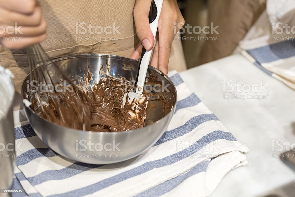 whisking chocolate cake stock photo