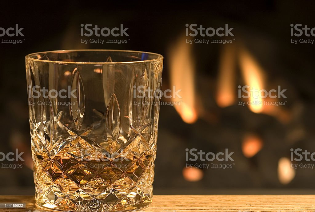 Whisky at the fireside stock photo