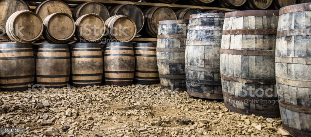 Whisky barrels in the store house stock photo