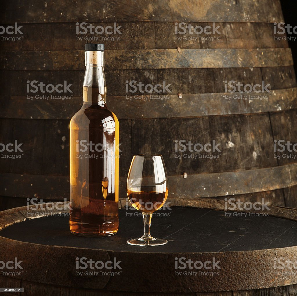 Whisky bottle and glass stock photo
