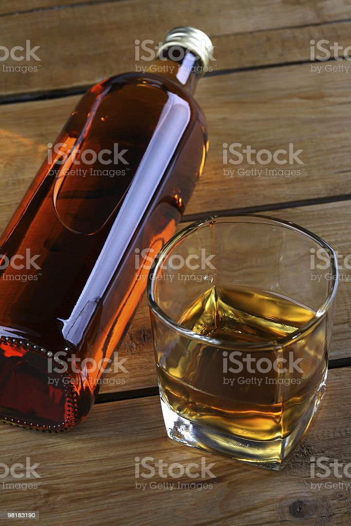 Whisky Bottle and Glass Wood Style royalty-free stock photo