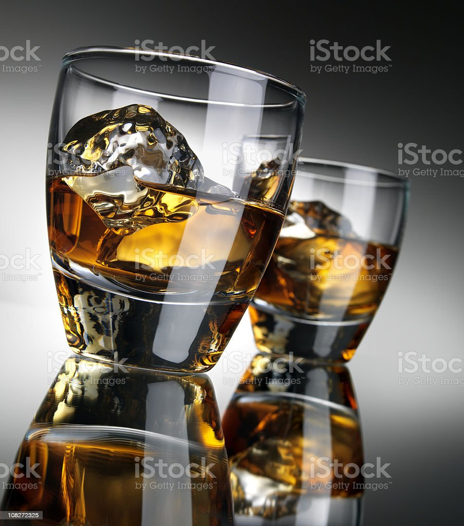 Whisky cocktail over ice, Reflections stock photo