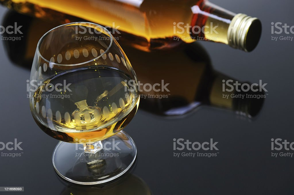 Whisky Glass with Bottle on Black royalty-free stock photo