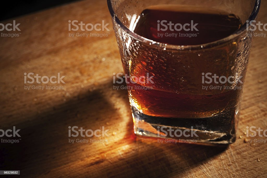 whisky on a wooden table royalty-free stock photo