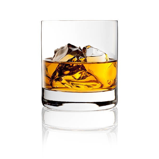 whisky on the rocks - drink with ice - glass stock photos and pictures