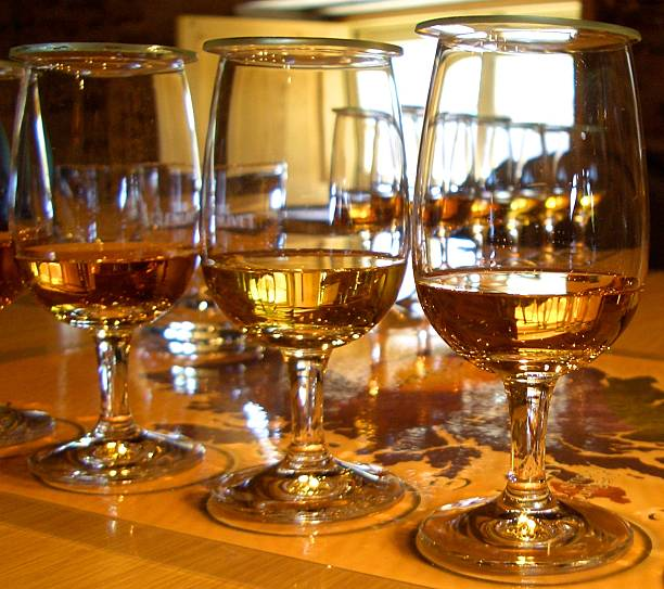 whisky tasting Scotch whiskey glasses in a row stock photo