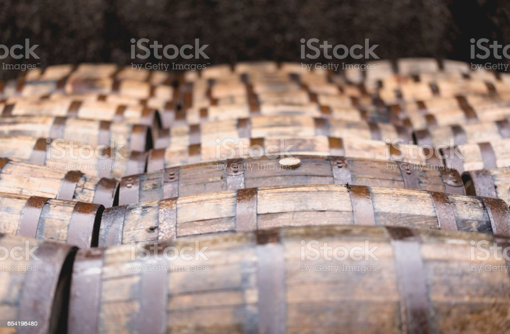 Whisky vintage old barrels full of whiskey stock photo