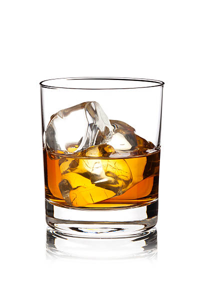 whisky with ice cubes - whiskey stock photos and pictures