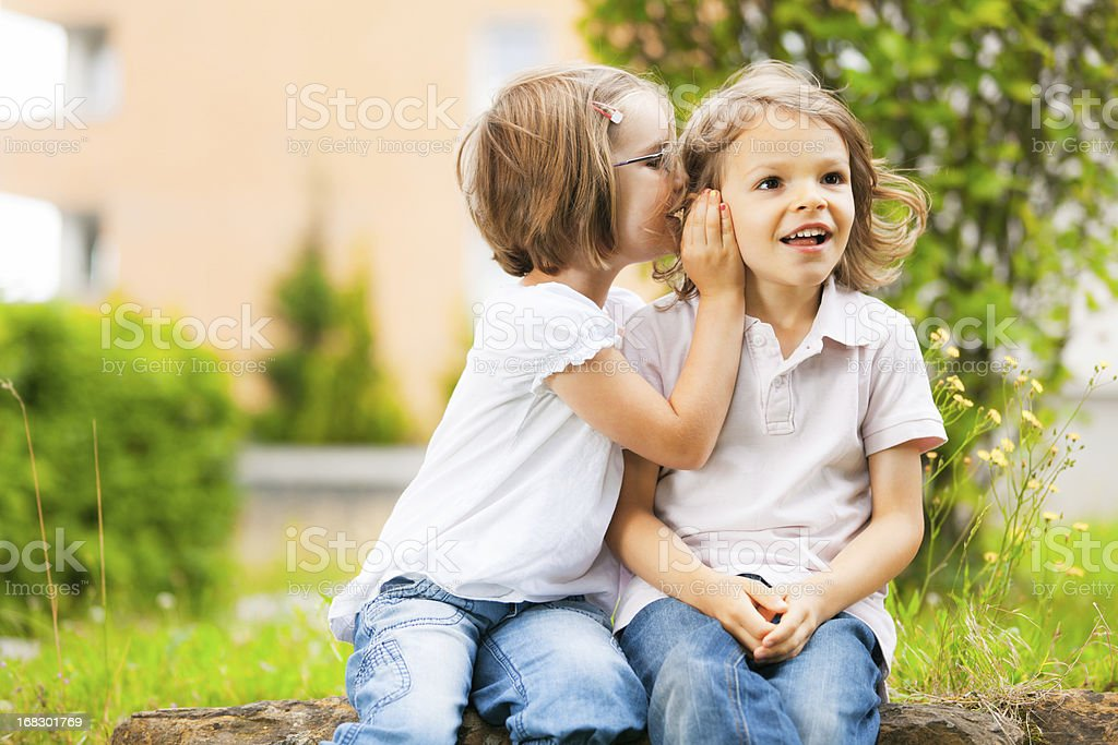 whispering a secret royalty-free stock photo