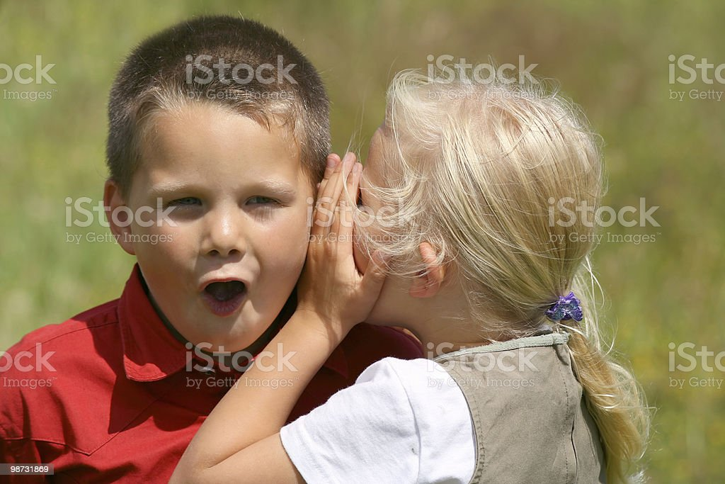 Whispering and stunned royalty free stockfoto