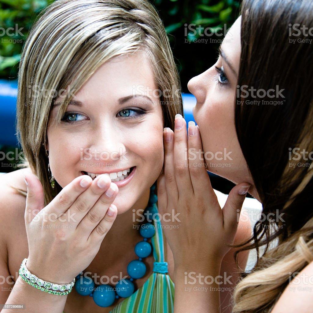 Whispering Girls royalty-free stock photo