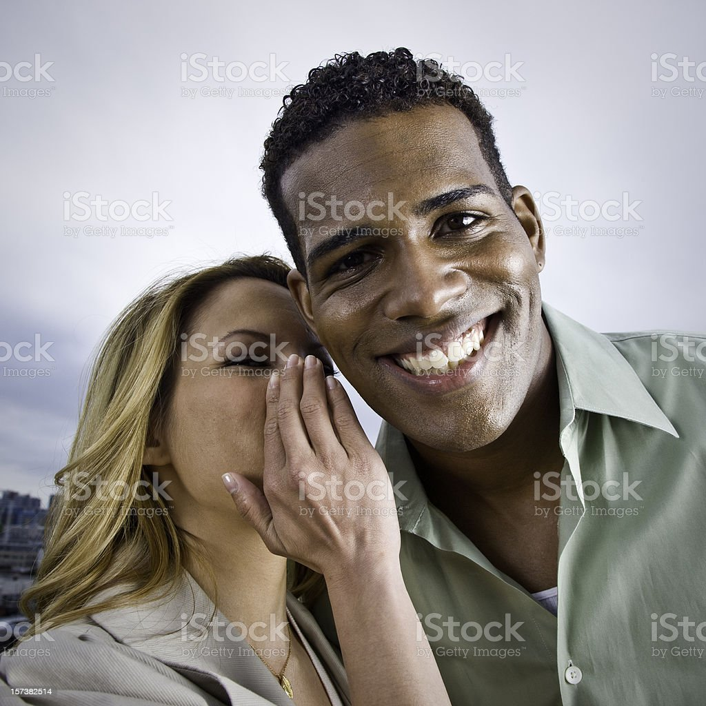 Whispering in the Ear royalty-free stock photo