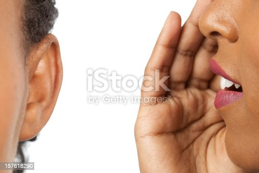 Women whispering and listening to gossip isolated on a white background.