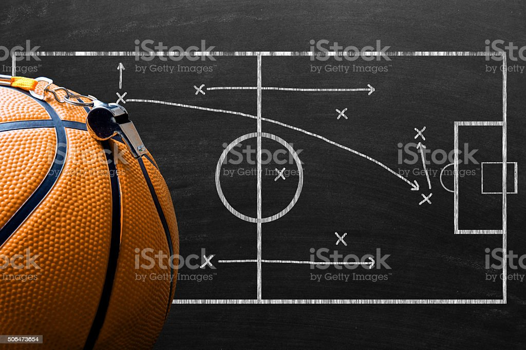 Whistle and basketball against game plan stock photo