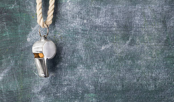 whistle of a football referee or trainer stock photo