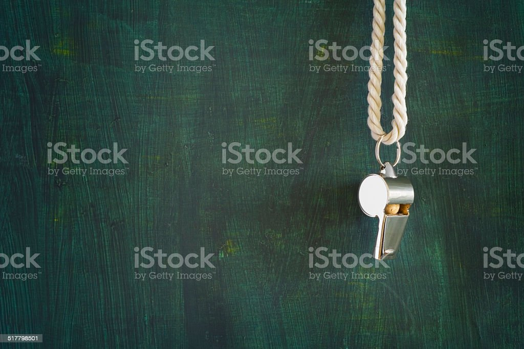 whistle of a referee stock photo