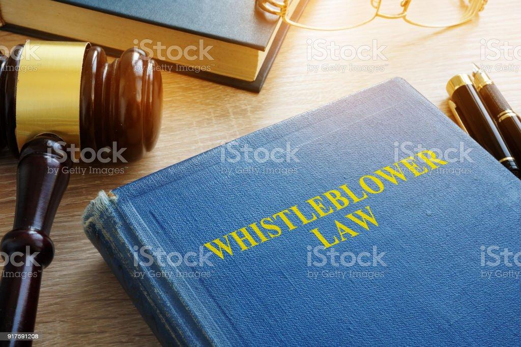Whistleblower law on a court desk. Whistleblower law on a court desk. Breaking Stock Photo
