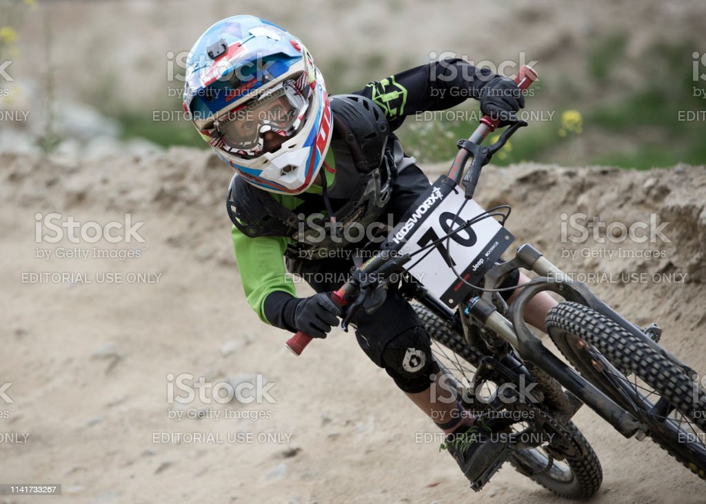A young boy competes in the Crankworx Kidsworx Downhill Mountain Bike...