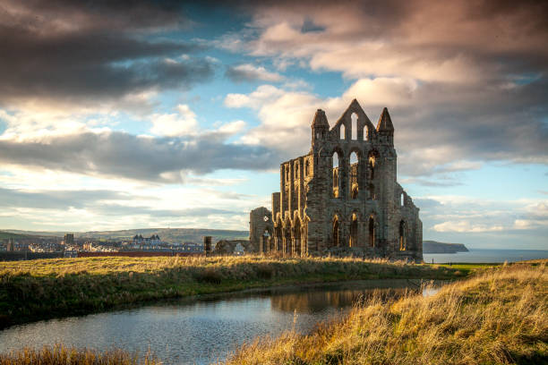 Whitby Abbey The Ruins of Whitby Abbey on the headland above Whitby North Yorkshire UK abbey monastery stock pictures, royalty-free photos & images