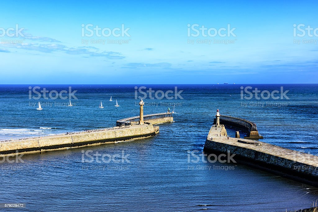 Whitby harbour entrance lighthouses, England stock photo