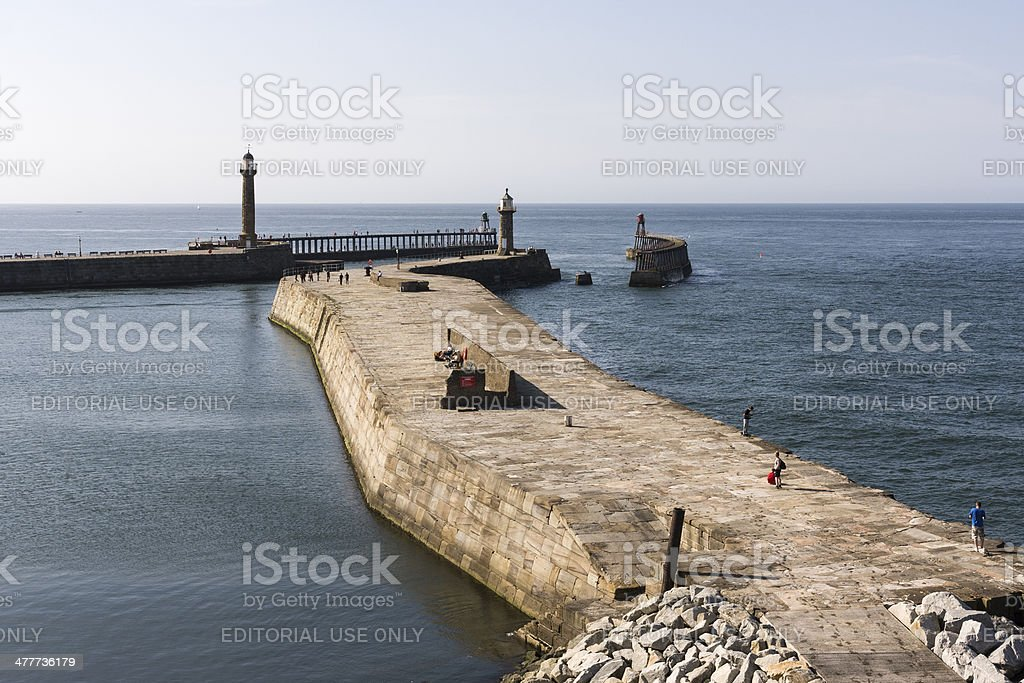 Whitby harbour entrance on the coast of North Yorkshire royalty-free stock photo