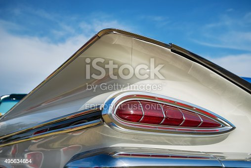 Westlake, TX, USA - October 17, 2015: Tail fin and taillight details of a white 1959 Chevrolet Impala Convertible classic car.