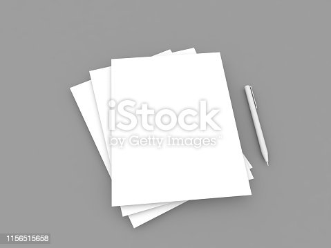 istock White A4 paper sheets and pen on a gray background. 1156515658