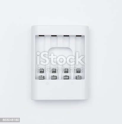 istock White AAA AA Battery charger isolated on white 853048180