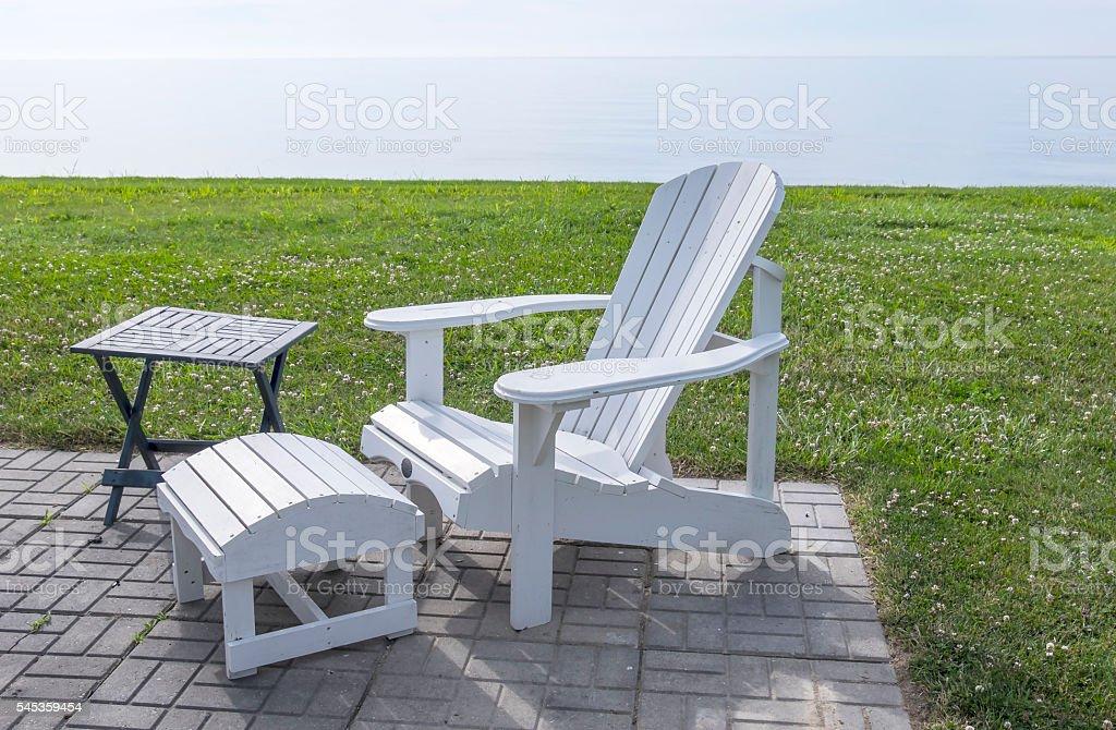 White Adirondack Chair by Lake Erie stock photo