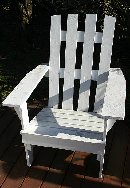 white adirondack chair stock photo