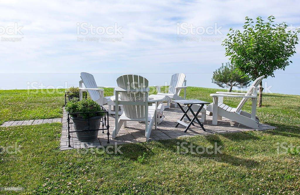 White Adirondack Chairs by Lake Erie stock photo