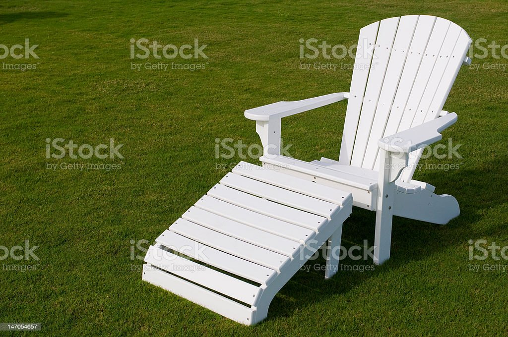 White adirondack lounge chair in green grass\nWhite adirondack lounge chair in green grass\nWhite adirondack lounge chair in green grass\nWhite adirondack lounge chair in green grass\nWhite adirondack lounge chair in green grass\n royalty-free stock photo