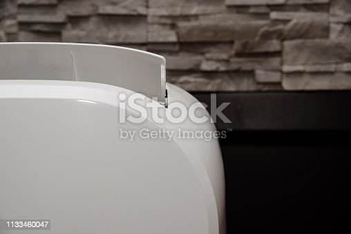 istock White air conditioner in the apartment. The concept of cooling and cleaning the air at home. 1133460047
