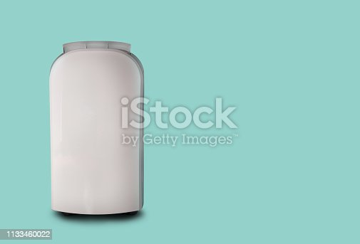 istock White air conditioner on a green pastel background. 1133460022