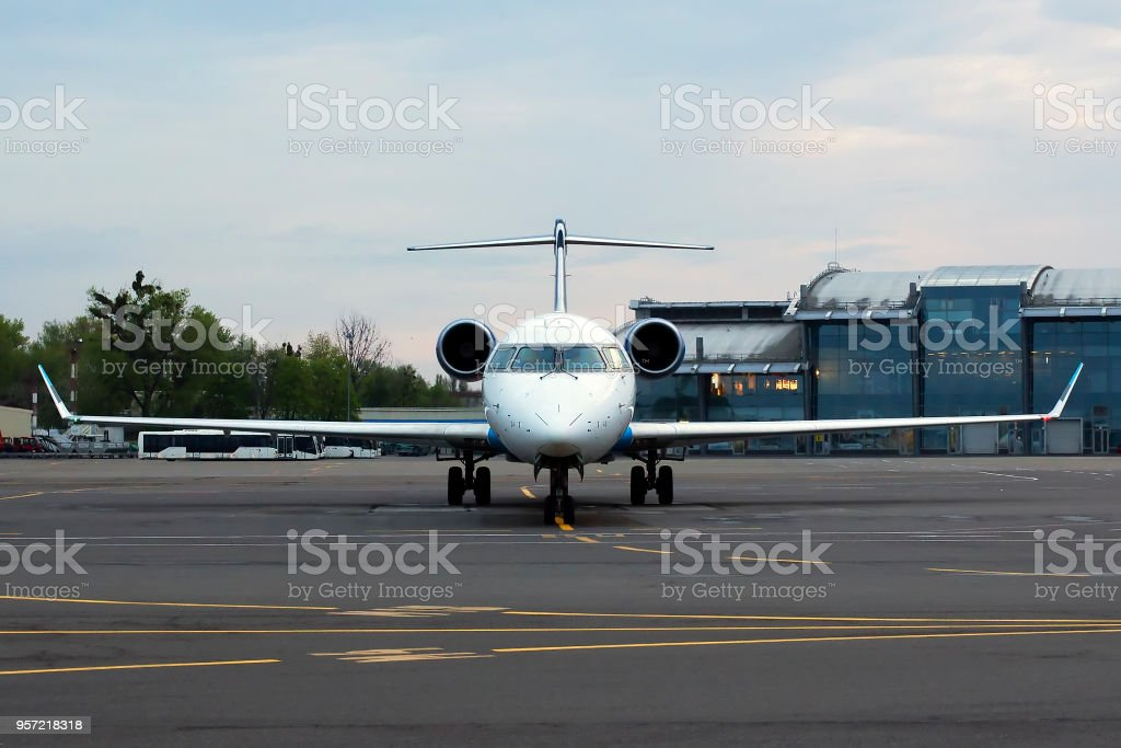 White aircraft on the parking zone stock photo