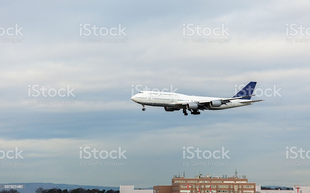 White airplane during landing stock photo