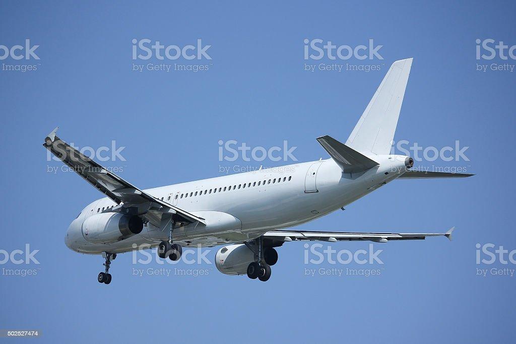 White Airplane landing stock photo