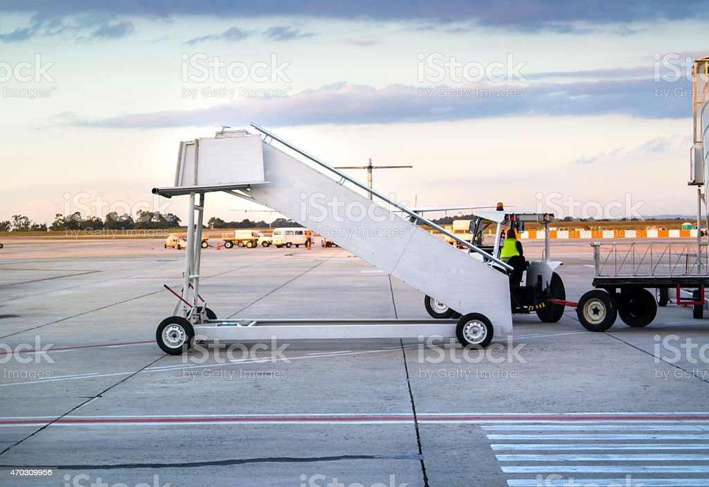 White airplane stepladder at an airport. stock photo