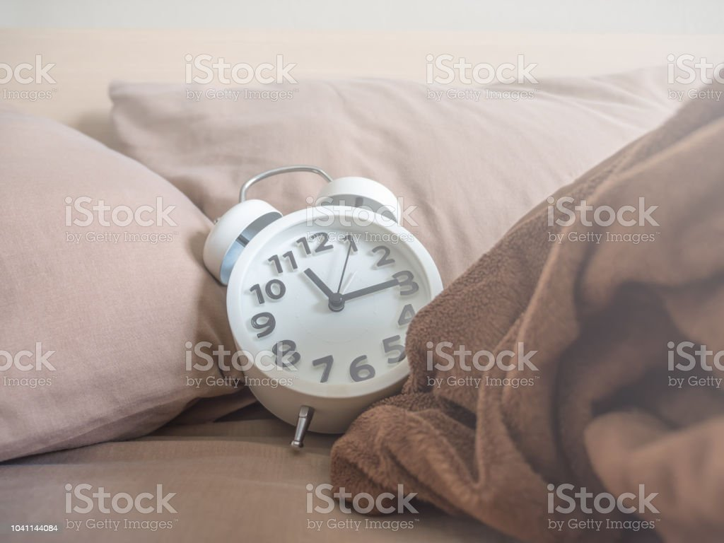 White Alarm Clock In The Bedroom Stock Photo - Download Image Now ...