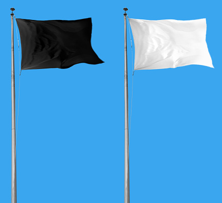 White and black flags attached to a flagpole waving over blue sky