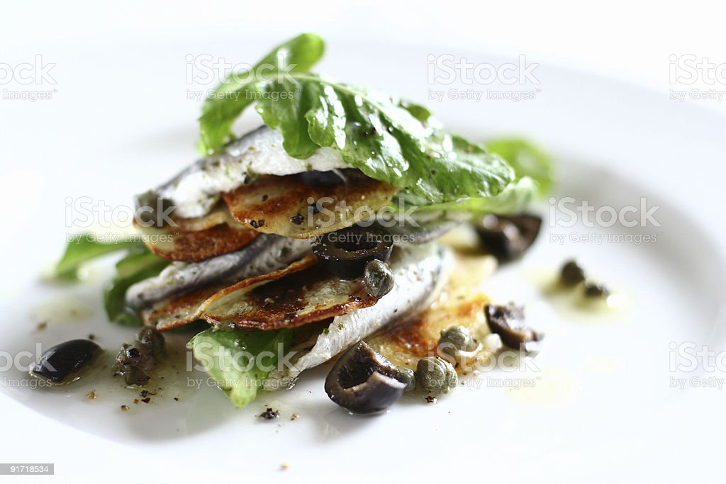 white anchovy, rocket, potato salad royalty-free stock photo