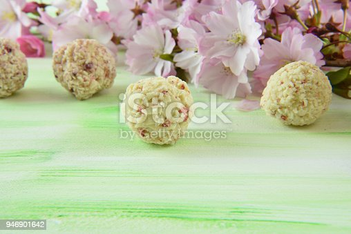 istock white and berry chocolate truffles and pink blossom 946901642
