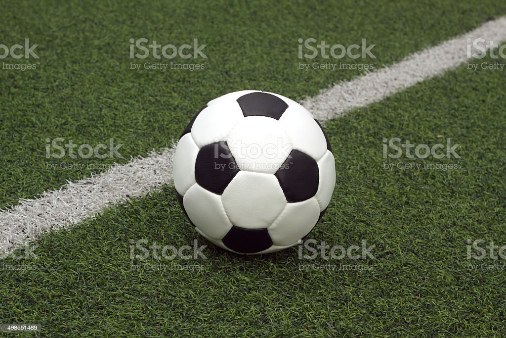 White and black ball for playing soccer near line close-up royalty-free stock photo