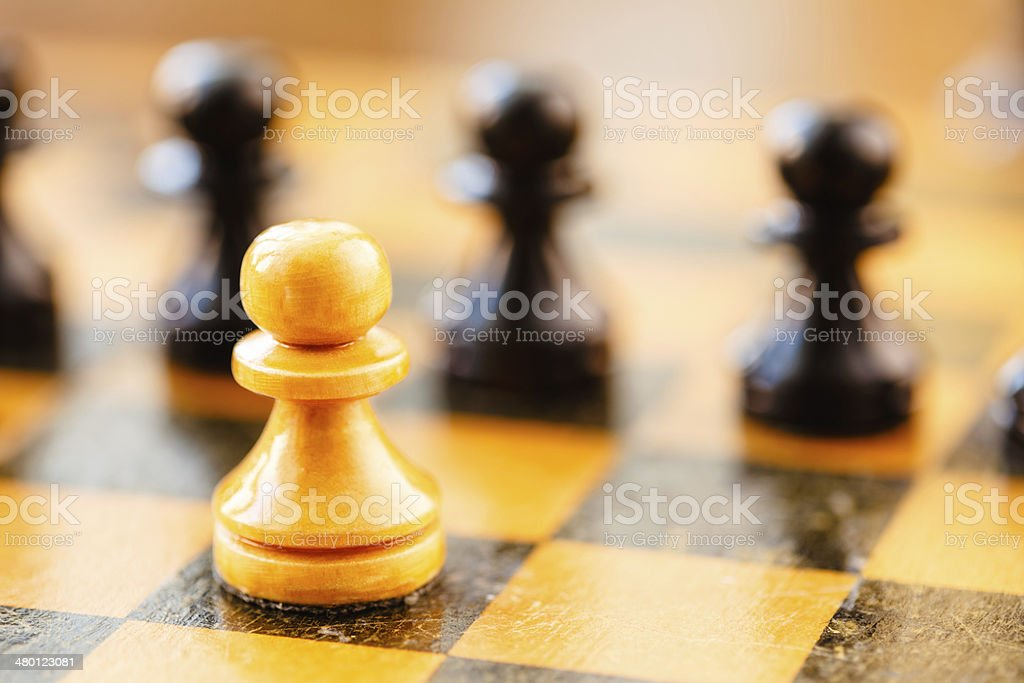 White and black chess pawns standing on chessboard royalty-free stock photo